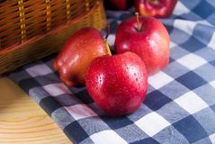Fresh red apple on wooden table. Apples are extremely rich in important antioxidants, flavanoids, and dietary fiber royalty free stock photo