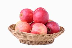 Fresh red apples in a basket, isolated on white royalty free stock photo