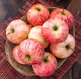 Fresh red apples in a basket Royalty Free Stock Photos