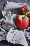 Fresh red apples on cotton towels Royalty Free Stock Photo