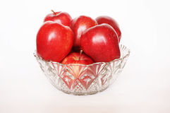 Fresh red apples in crystal glass bowl Stock Images