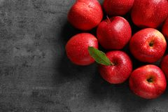 Fresh red apples with drops of water. On grey background Stock Photos