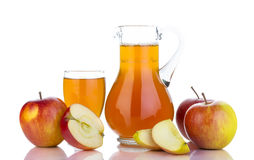 Fresh red apples, glass with juice and carafe Royalty Free Stock Photo