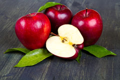 Fresh red apples with leaves  Royalty Free Stock Image