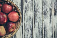 Fresh red apples. Natural apples in a wicker basket stock photo