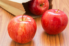 Fresh red apples with paper bag Stock Photography