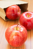 Fresh red apples with paper bag Stock Photos