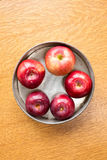 Fresh red apples in pie tin. Fresh red pie apples in a metal tin Royalty Free Stock Photo