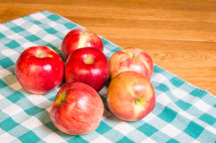 Fresh red apples on the table Royalty Free Stock Photos