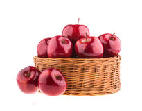 Fresh red apples in a wicker basket Stock Photos