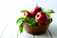 Fresh red apples in the wicker basket Stock Photos