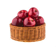 Fresh red apples in a wicker basket. Vegetarian. Royalty Free Stock Photography