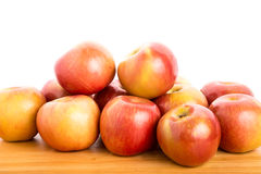 Fresh Red Apples on a Wood Table with White Background Stock Image
