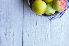 .apple background. On a white wooden table. In a rustic style. Books