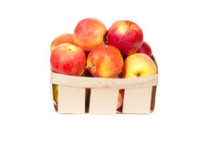 Fresh red apples in wooden basket isolated, autumn harvest Stock Images