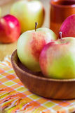 Fresh red apples on wooden plate. Fresh red apples on wooden table and plate Stock Photo