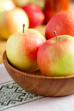 Fresh red apples on wooden table. And plate Royalty Free Stock Photo