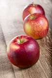 Fresh Red Apples. On the wooden table Stock Photos