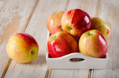 Fresh red  apples  on a wooden table Stock Photos