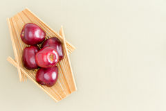 Fresh Red Apples on Wooden Tray at the Table Stock Photo