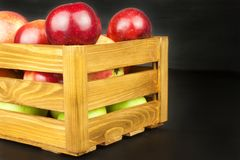 Fresh red autumn apples in farmhouse style wooden crate. Sales of farm products. Advertising for the sale of fruit. Royalty Free Stock Photos