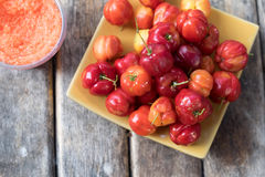 Fresh red barbados cherry. On wood table Stock Image