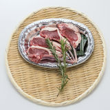 Fresh red beef cow ribs with rosemarry on bamboo tray Royalty Free Stock Photo