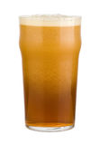 Fresh red beer. Fresh red or brown beer with a deep froth in a pint glass. Isolated on white Stock Photos