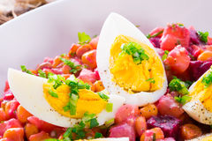 Red beet salad with egg Stock Photos