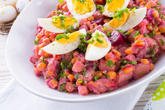 Red beet salad with egg Royalty Free Stock Image