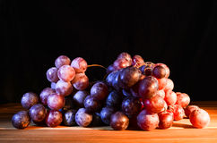 Fresh red blue wine grapes. On a table Royalty Free Stock Image