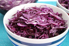 Fresh red cabbage. Some slices of a fresh red cabbage in a bowl stock images