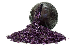 Fresh red cabbage with pieces coming out Royalty Free Stock Photography