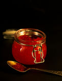 Fresh red caviar selective focus dark photo Stock Photography