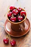 Fresh red cherries in bowl Royalty Free Stock Photos