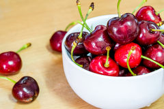 Fresh red cherries fruit on wooden floor background Stock Photos