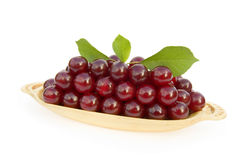 Fresh red cherries in the wooden bowl Stock Photo