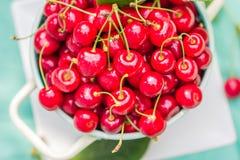Fresh red cherry fruit green colander Stock Photos