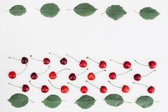 Fresh red cherry and leaf pattern on white background. Concept of healthy eating. Flat lay, top view, stock images