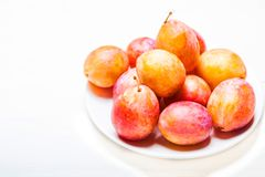Fresh  red cherry plums on white wood texture background with co. Py space Royalty Free Stock Photos
