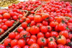 Fresh red cherry tomatoes in the basket Stock Photo