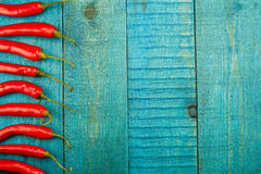 Fresh red chili pepper on old wooden background Stock Images