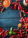 Fresh Red Chili Pepper. Spices on wood Stock Image