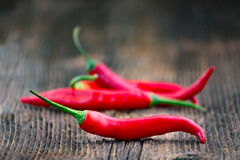 Fresh red chilli pepper on a wooden table Royalty Free Stock Image