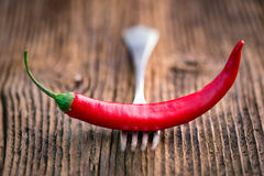Fresh red chilli pepper on a wooden table Royalty Free Stock Images
