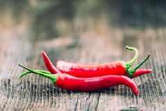 Fresh red chilli pepper on a wooden table Stock Image