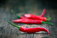 Fresh red chilli pepper on a wooden table. Organic vegetables Royalty Free Stock Photography