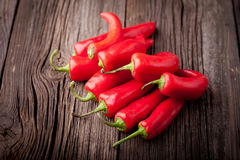 Fresh red chilli on a wooden table Stock Photo