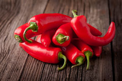 Fresh red chilli on a wooden table Stock Photography