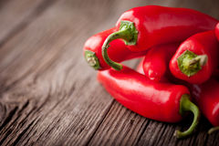 Fresh red chilli on a wooden table Royalty Free Stock Photos